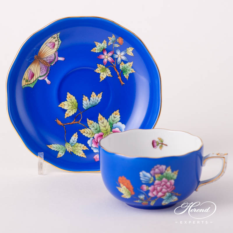 Tea Cup w. Saucer 20724-0-00 VE-FB Queen Victoria VBO design on Blue Background. Herend fine china